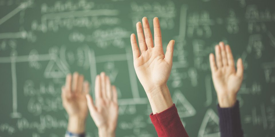 Hands Raised in the Classroom